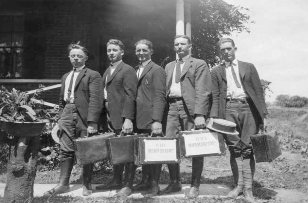 """Eastern States missionaries—Elders Ducy, Bunker, Eldrige, Wardell, and Moore—with briefcases labeled """"Why Mormonism,"""" Middletown, New York, 1923. Courtesy CHL."""